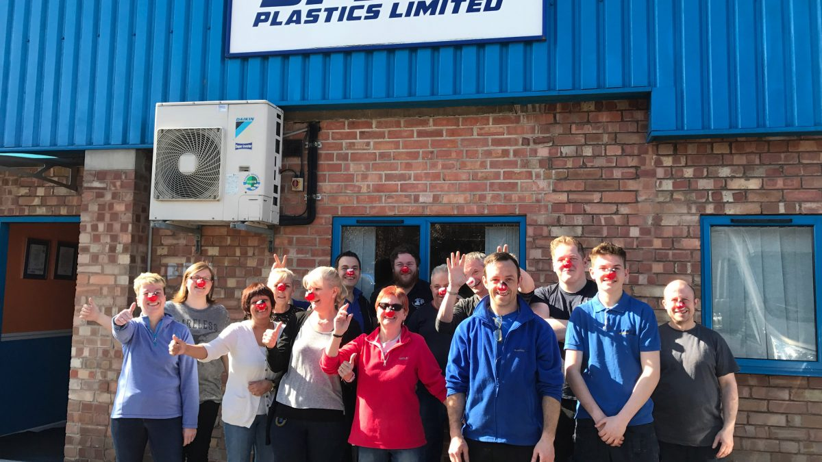 Speed Plastics team wear red noses